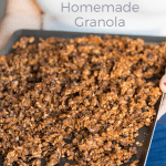 Granola on a tray hold by a woman