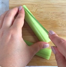 A knife cutting celery