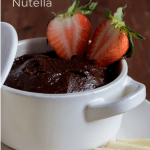Healthy Nutella in a bowl served with strawberries and apples