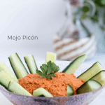 Mojo picón or red bell pepper spread served with cucumbers