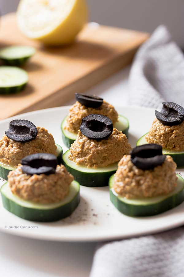 Cucumber appetizers with sardine spread and an olive on top