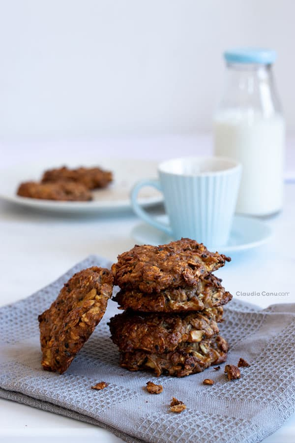 A pile of Oatmeal Cookies, a coffee mug and a bottle of milk