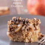 A plate with a piece of healthy apple crumble