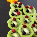 A tree made with kiwis and berries used as decoration