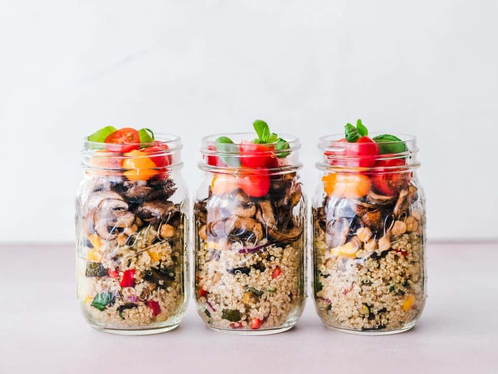 Jars with salads prepared with Meal Planning