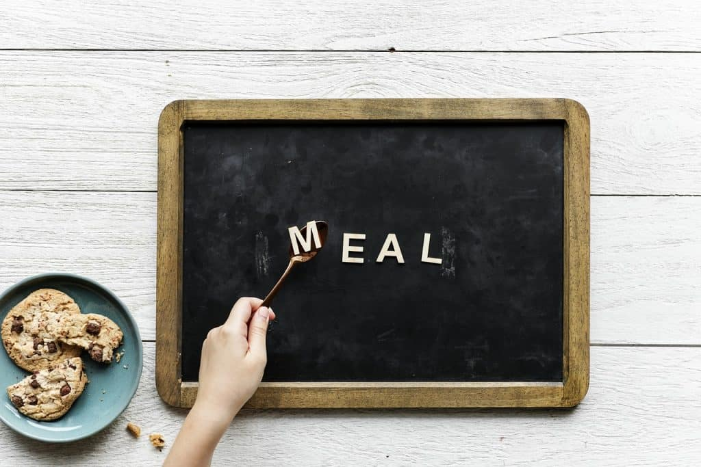 A black board with the word meal