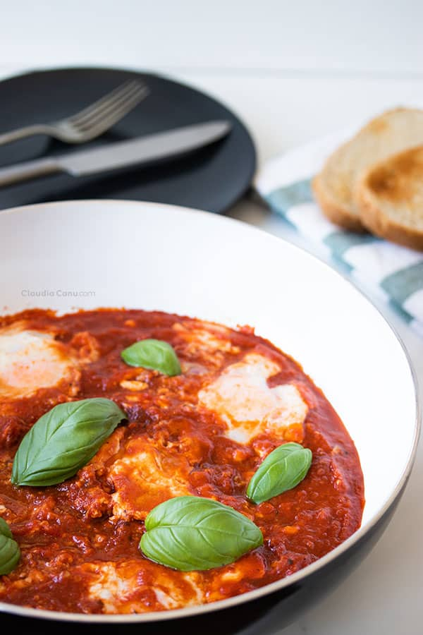A pan with eggs in tomato sauce called eggs in Purgatory