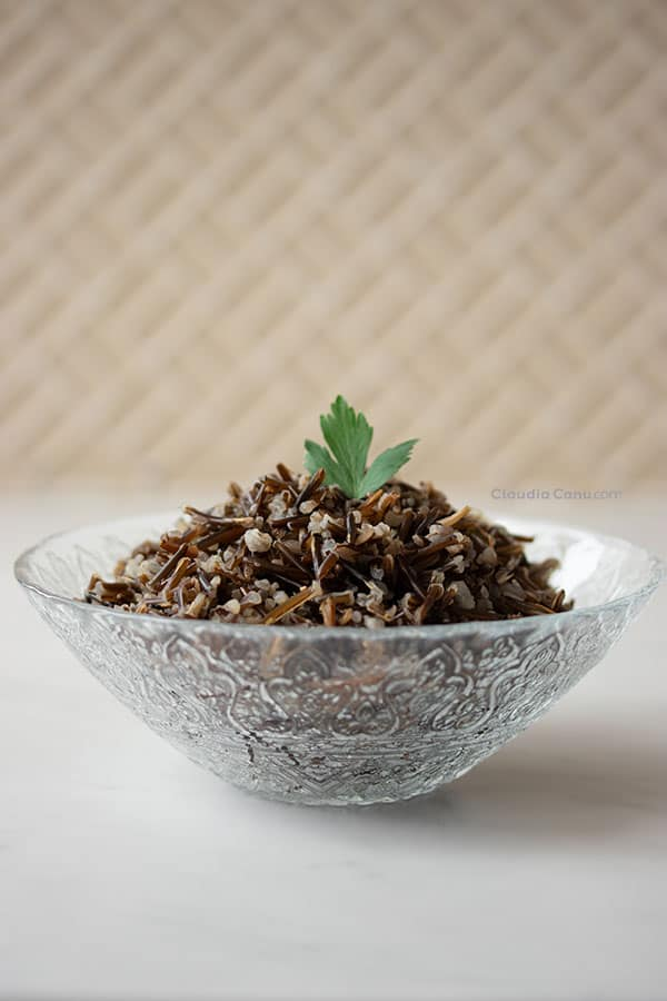 A bowl with black rice in it