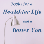 "A lamp and some books with the sentence ""Books for a healthier life and a better you"""