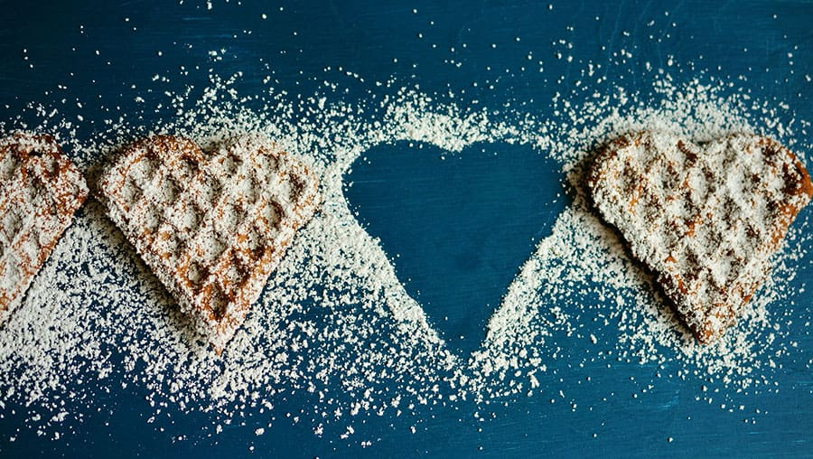 Pancakes in a heart shape with sugar on top