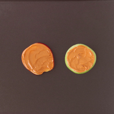 Two apple slices with peanut butter