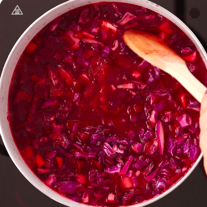 A pot with borscht cooking
