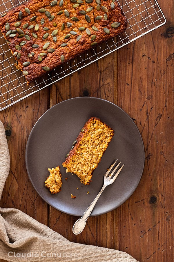 A slice of Healthy Pumpkin Bread on a plate