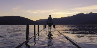 A man on a dock thinking positive affirmations